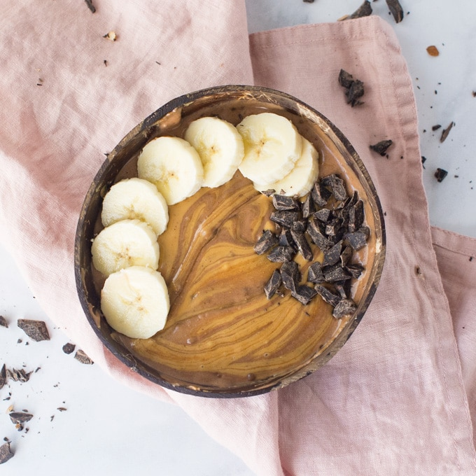 chocolate peanut butter smoothie bowl with banana and chocolate chunks