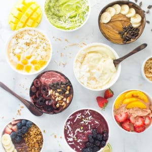 8 vegan and healthy smoothie bowls on marble background