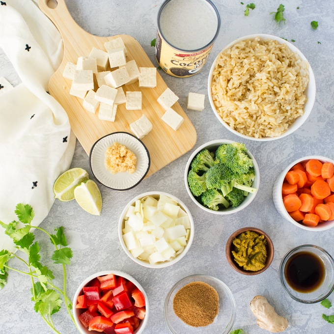 ingredients for vegan thai green curry on grey background
