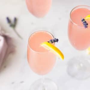 champagne flute of lavender lemonade mimosa