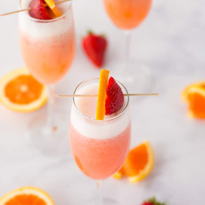 strawberry orange mimosa in champagne flute