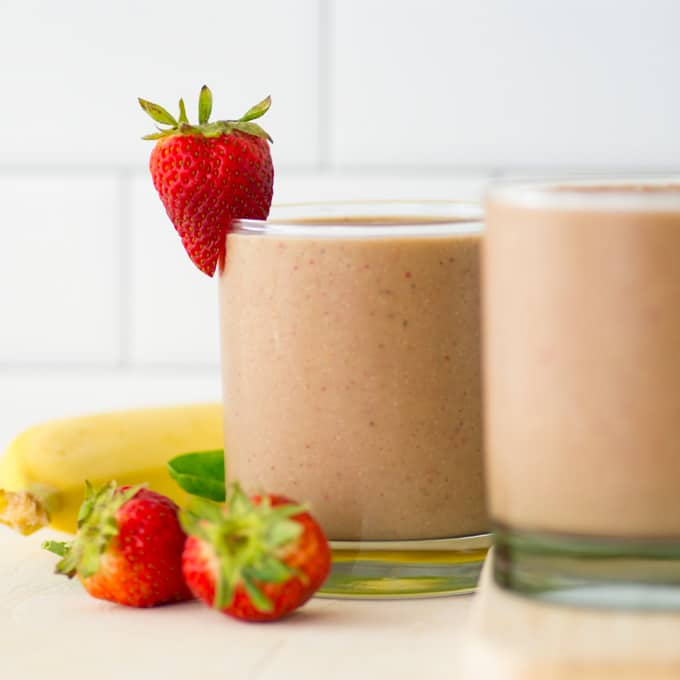 healthy vegan smoothie with strawberries and bananas