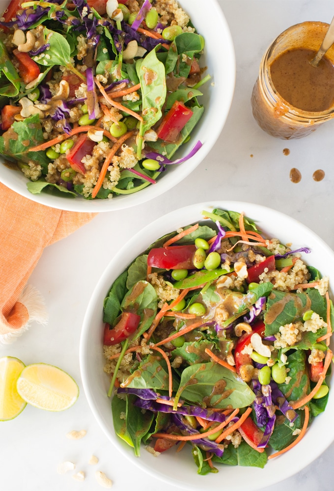 vegan thai quinoa salads with almond butter dressing on white background