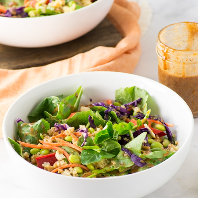 thai quinoa salad with almond butter dressing and limes