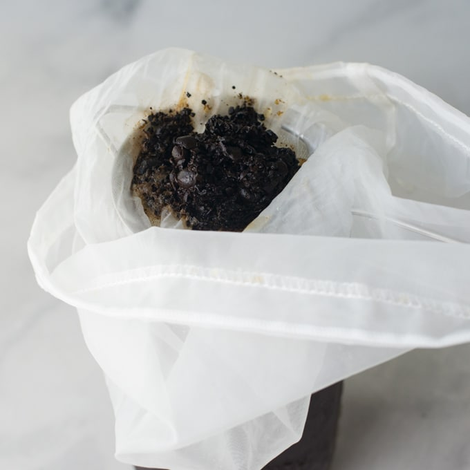 coffee grounds in nut bag - making cold brew