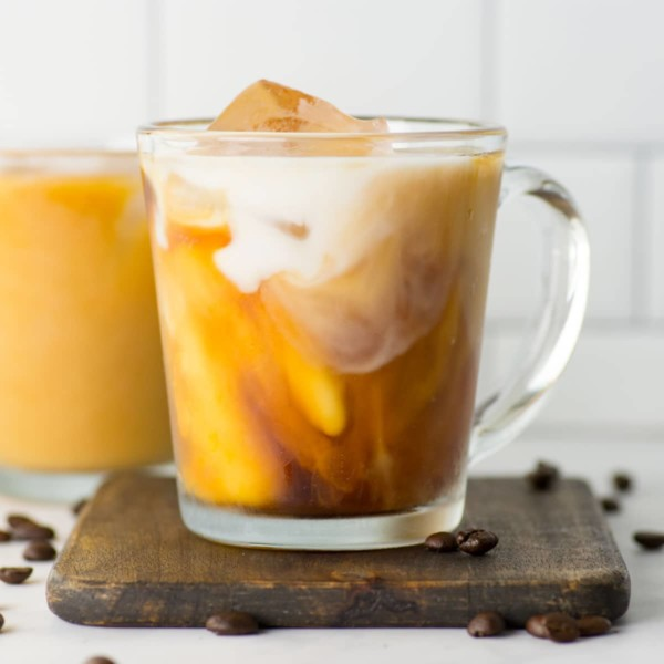 cold brew coffee in mug with almond milk