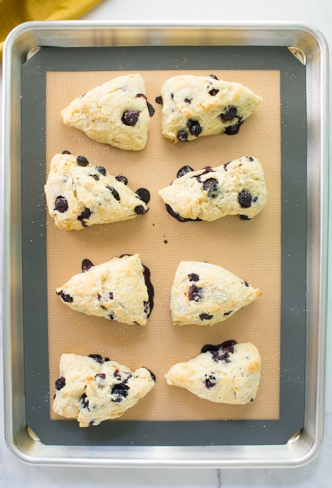 lemon blueberry scones on baking sheet