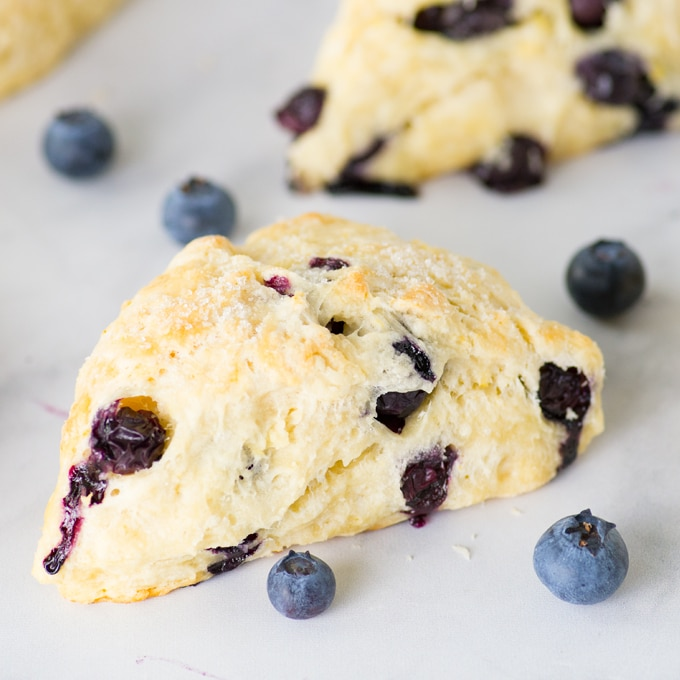vegan lemon blueberry scone on marble counter top