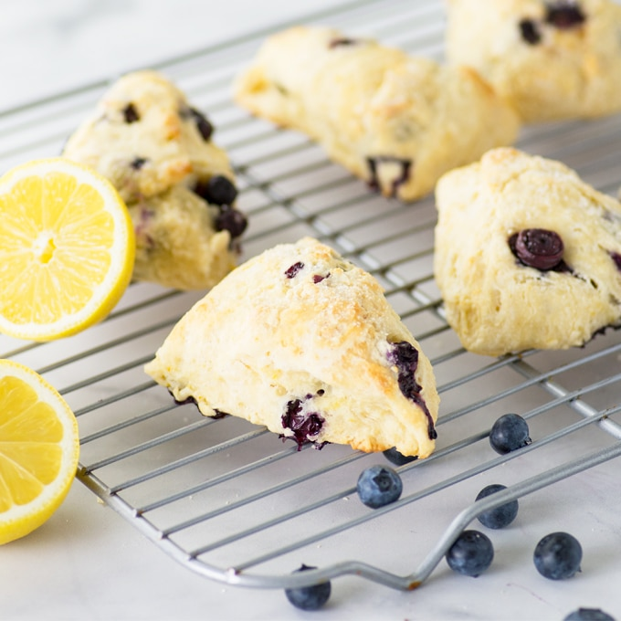 vegan scone on cooling rack with blueberries and lemons