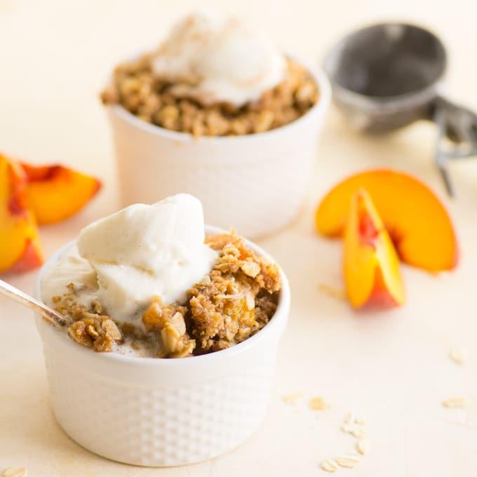 vegan peach crisp with vanilla ice cream
