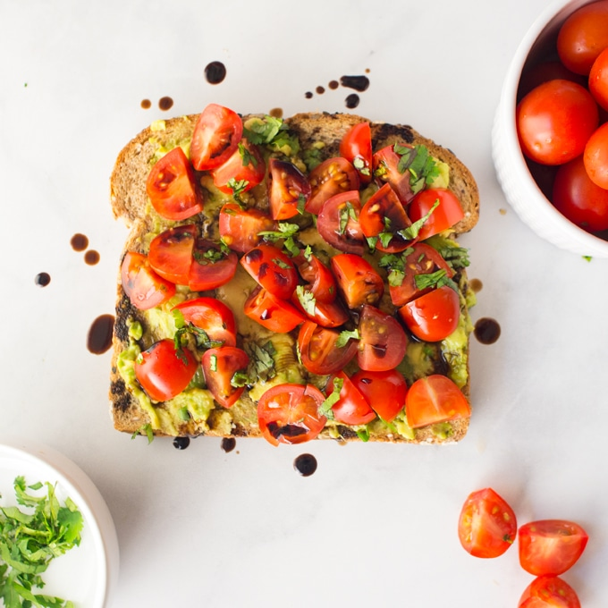 Avocado toast with tomatoes and balsamic reduction