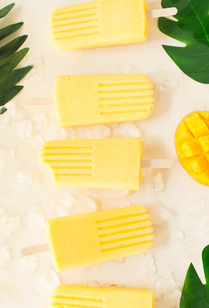 vegan mango popsicles with tropical leaves