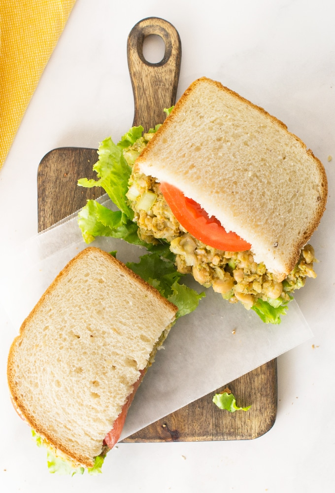 vegan chickpea salad sandwiches with lettuce and tomato