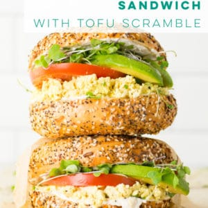 The best vegan breakfast sandwich to start your morning right! Everything bagel loaded with all the vegan toppings, this savory breakfast recipe is a must try! #vegan #breakfast #breakfastsandwich #veganbreakfastsandwich #tofuscramble | Mindful Avocado