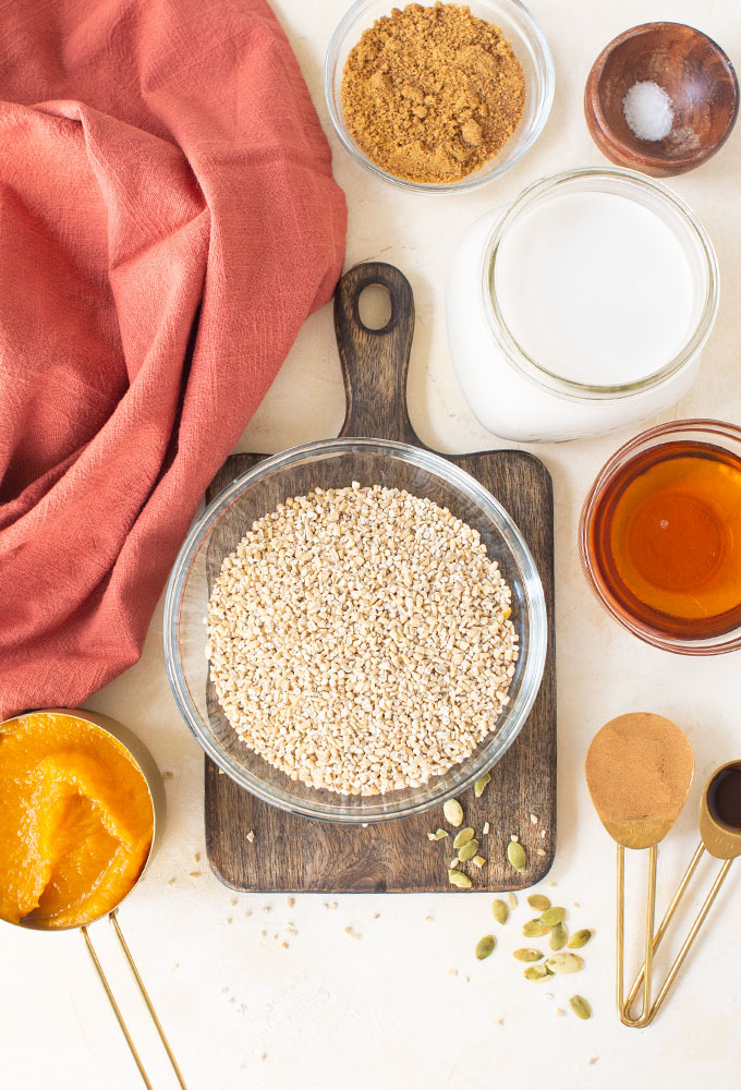 ingredients for pumpkin oatmeal on blush background
