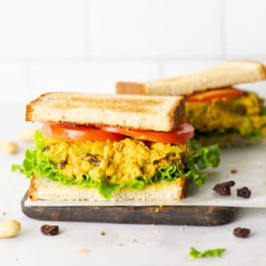 chickpea salad sandwich on whole grain bread with lettuce and tomato