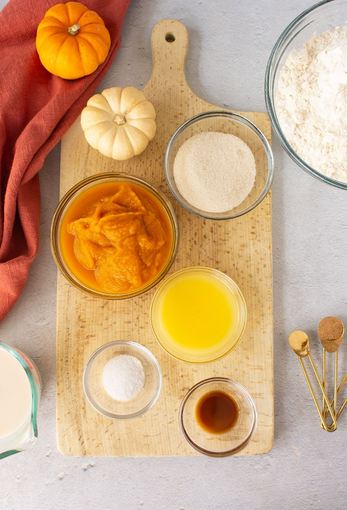 ingredients for pumpkin cinnamon rolls on grey background