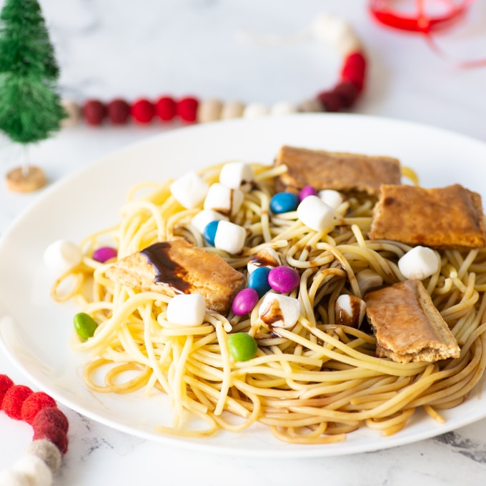 close up of buddy the elf spaghetti with marshmallows, chocolate syrup, candy, and pop tarts