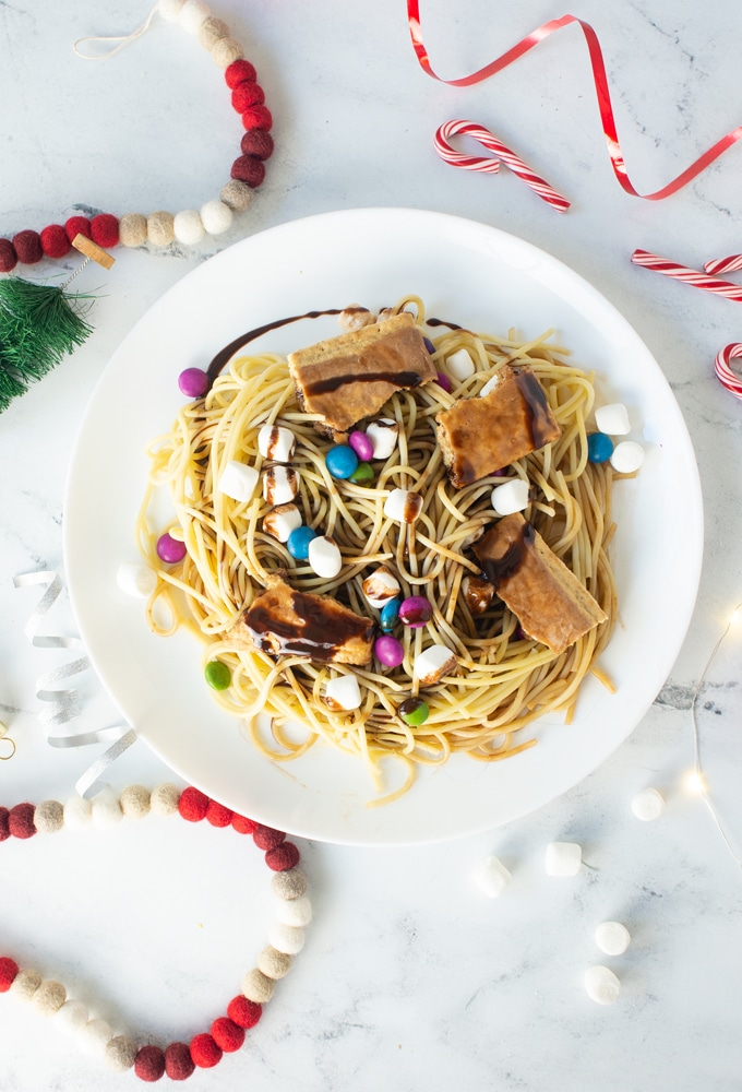 buddy the elf spaghetti on white background with christmas decorations