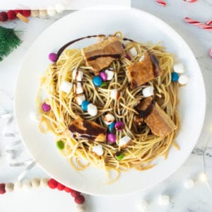 Buddy the Elf Spaghetti Recipe -- Sugar lover's rejoice! Learn to make the spaghetti our beloved Buddy the Elf makes in the Christmas movie Elf! Spaghetti topped with chocolate candies, marshmallows, chocolate syrup, maple syrup, and pop tarts! #buddytheelf #elfmovie #christmas #elfspaghetti #elfpasta | Mindful Avocado