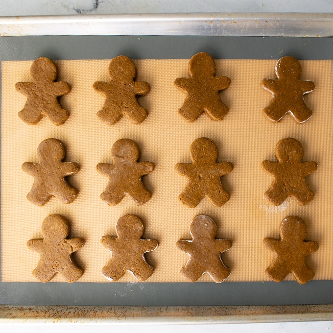 gingerbread men on baking sheet before baking