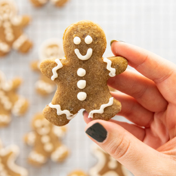 hands holding decorated gingerbread man