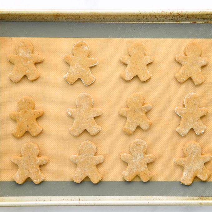 gingerbread men on baking sheet before baking