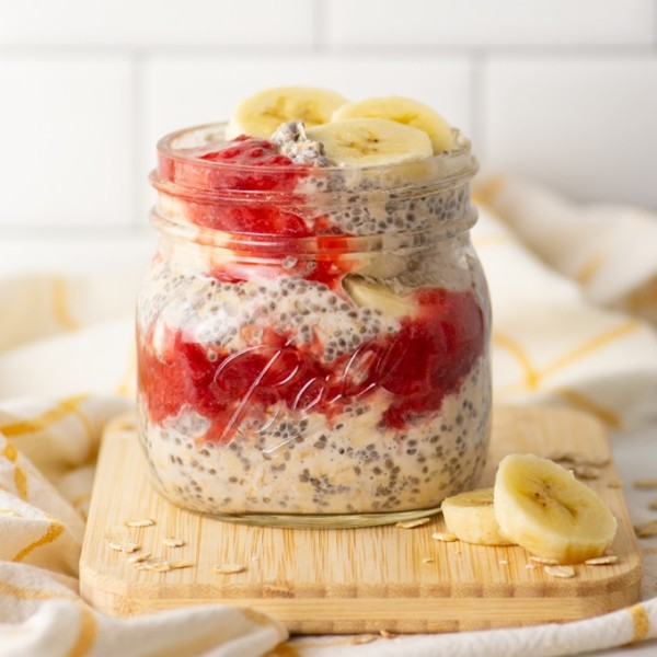 overnight oats with strawberry compote and banana slices