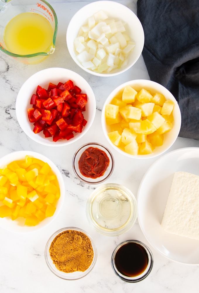 ingredients for sweet and sour tofu on marble background