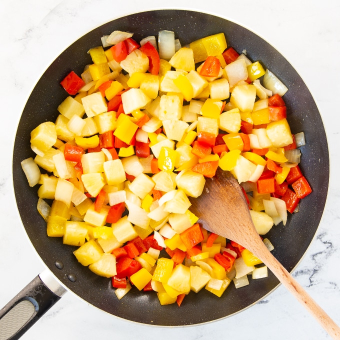 peppers and onion in large pan