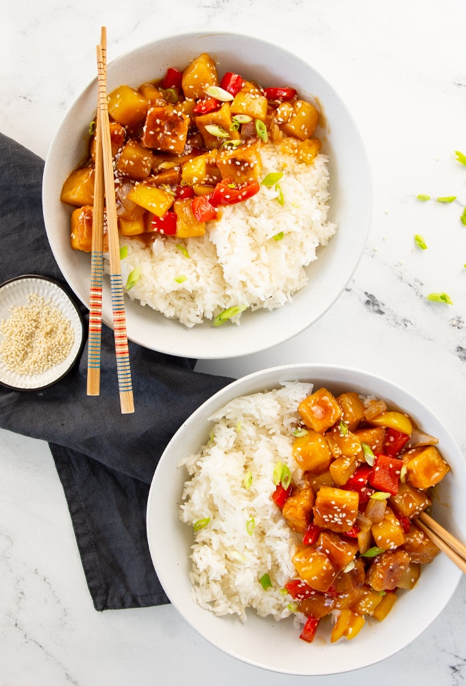 two bowls of sweet and sour tofu with rice