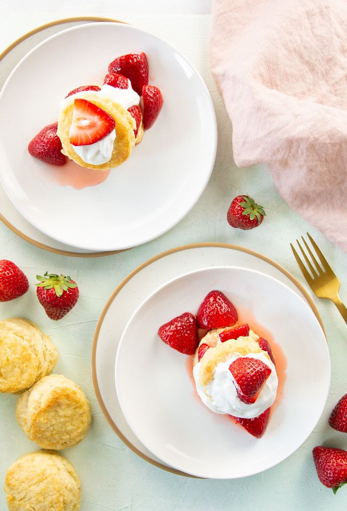 two white plates with strawberry shortcakes
