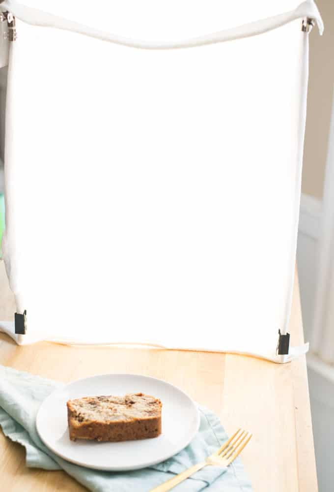 diy lightbox for food photography with slice of banana bread in front of it