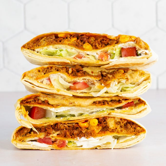 vegan crunchwrap supremes stacked on top of eachother