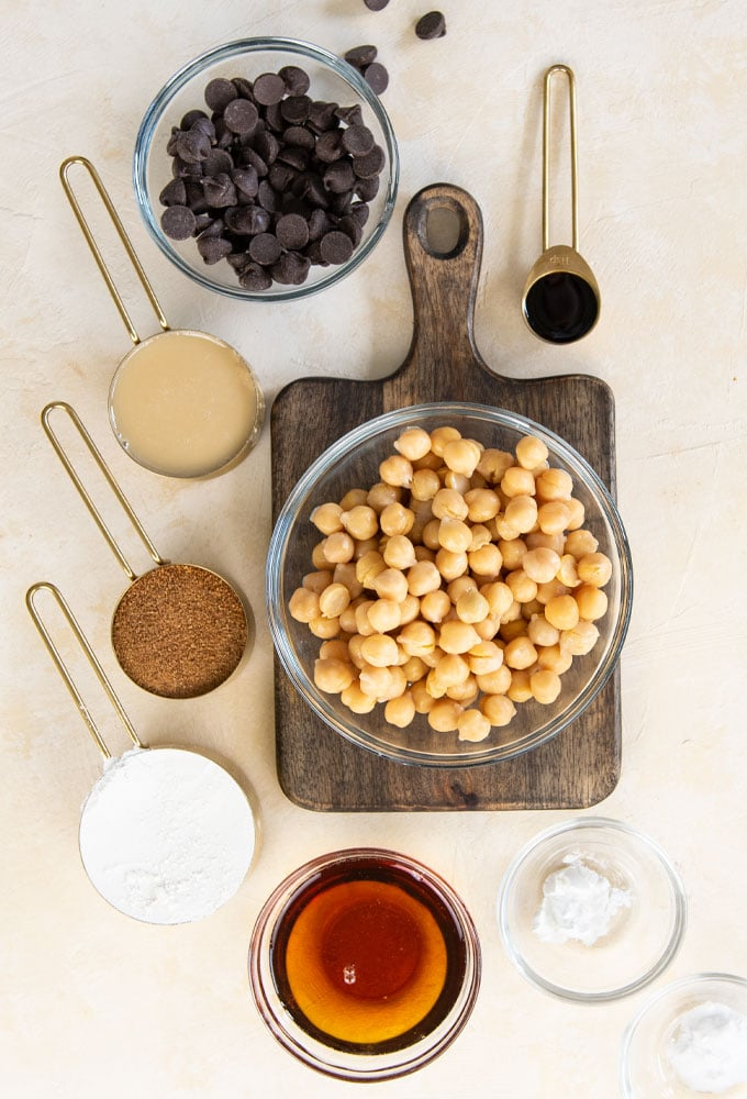 ingredients for chickpea blondies on cream background.
