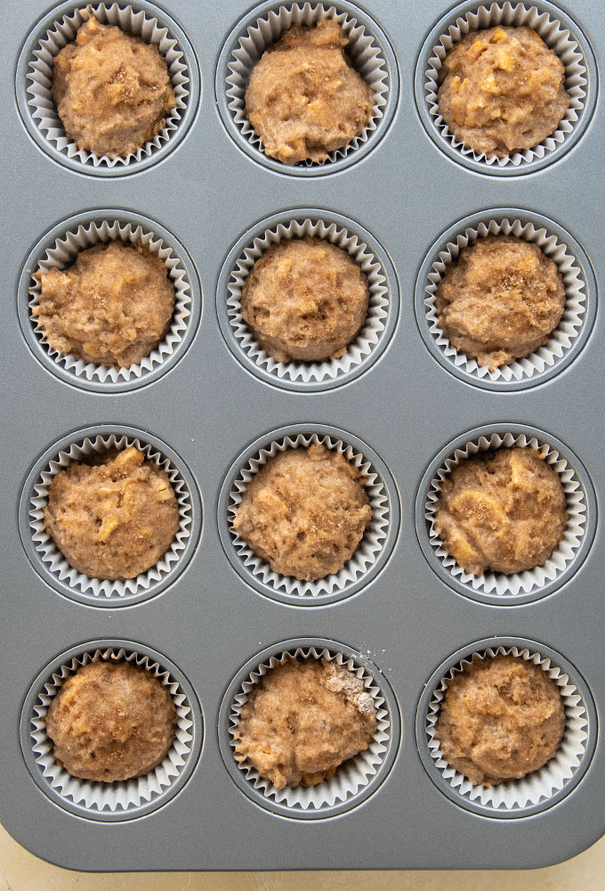 muffin batter in tin before baking