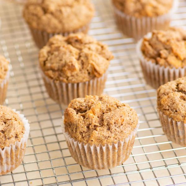 vegan apple cinnamon muffins on cooling rack