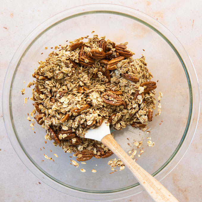 ingredients for granola in a mixing bowl