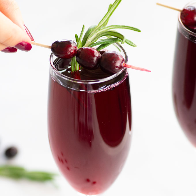 mimosas made with cranberries and champagne