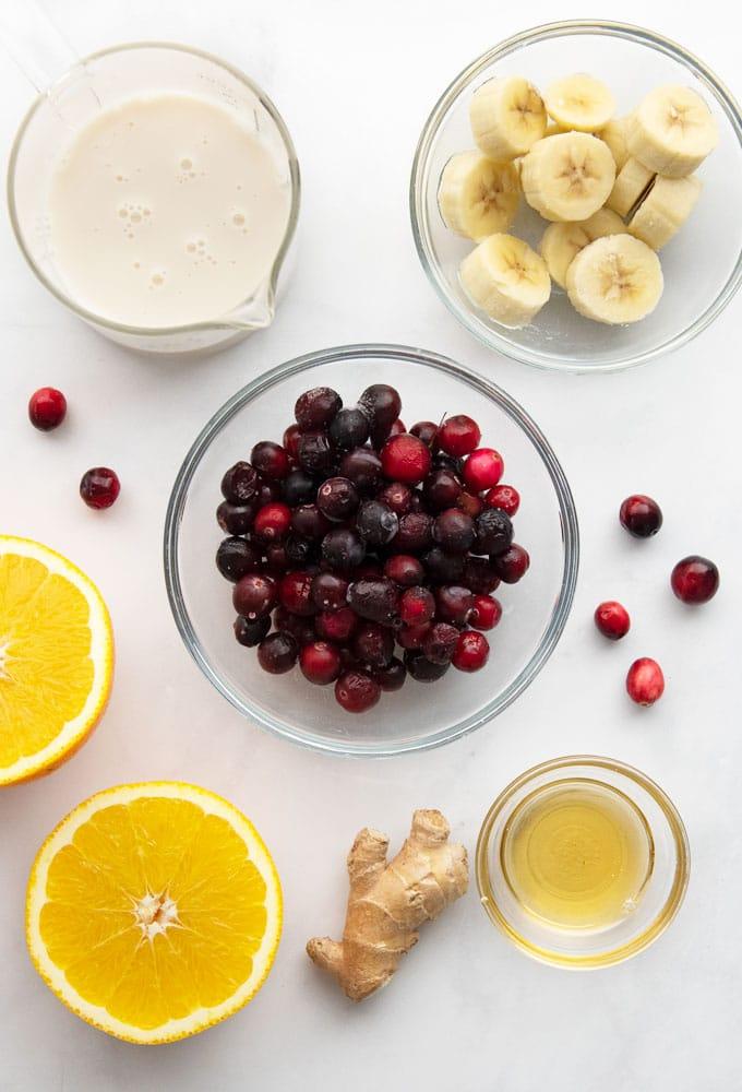 cranberries, banana, almond milk, oranges, and ginger