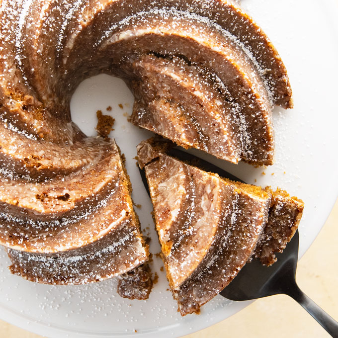 overhead shot of a gingerbread bundt cake with a slice taken out