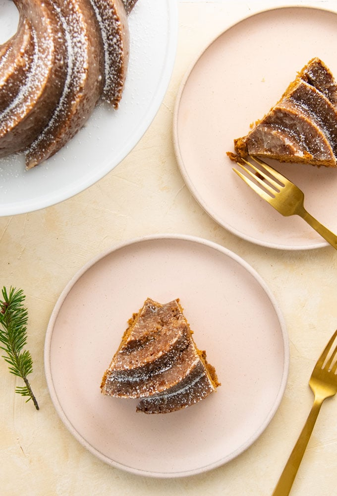 two slices of gingerbread bundt cake on pink plates