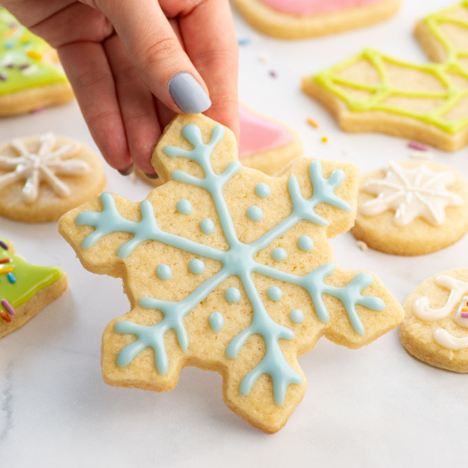 snowflake cookie decorated with royal icing