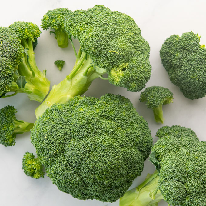 broccoli florets on white background