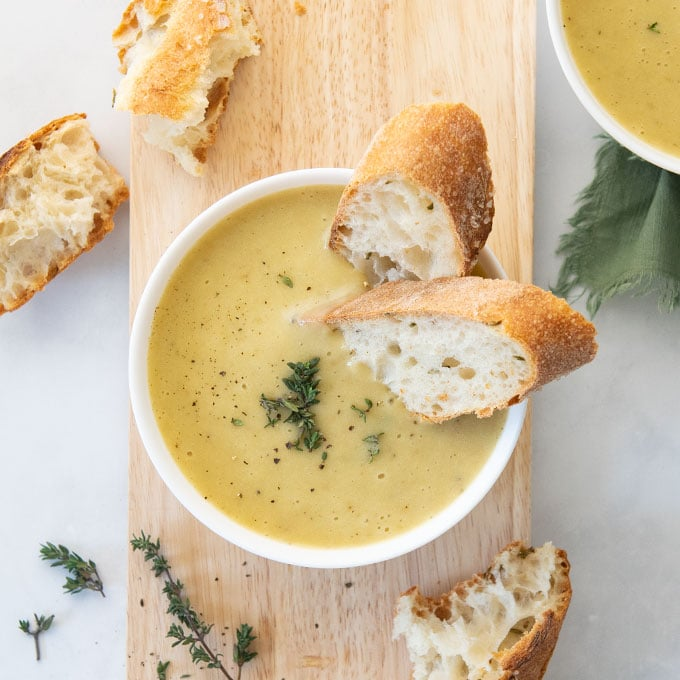 vegan potato leek soup with bread and thyme