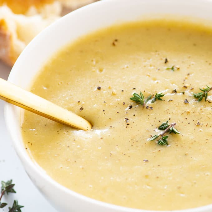 close up of creamy soup with potatoes and leeks