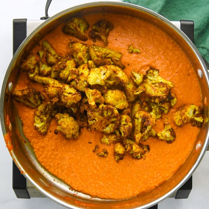 simmering the florets in cashew tomato sauce