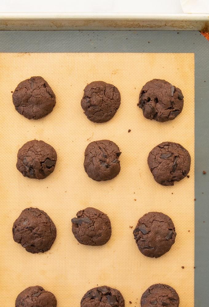 chocolate chocolate chunk cookies on baking sheet