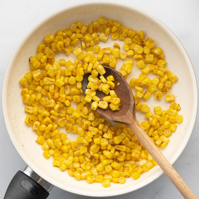 grilled corn in a small pan