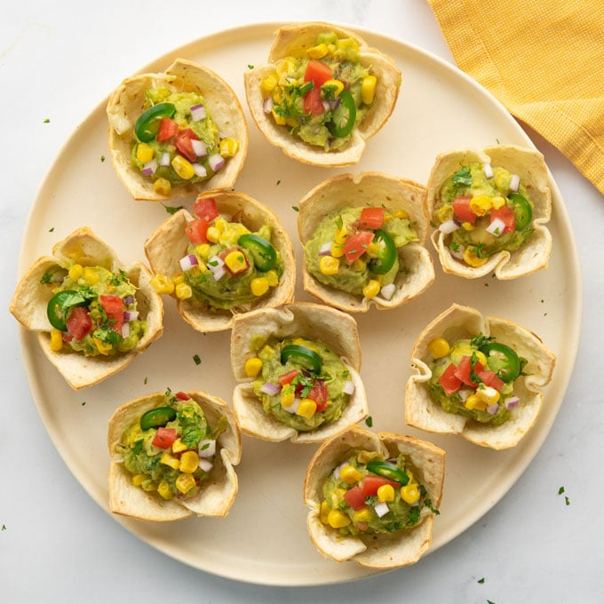 guacamole cups on a plate
